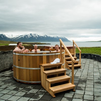 Young men relaxing in the hot tub of the beer spa